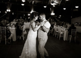 newly married couple dance at wedding reception