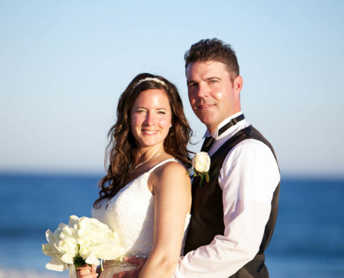 bride and groom pose for their Cabo destination wedding portrait