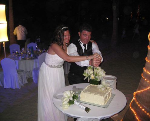 bride and groom cut cake at destination wedding
