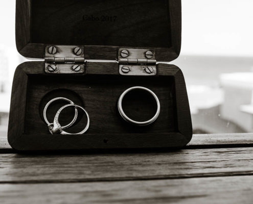 wedding rings with beach in background