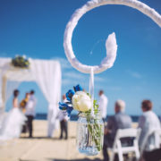 beach wedding details with couple in distance