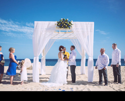 couple get married under canopy at beach wedding in Cabo