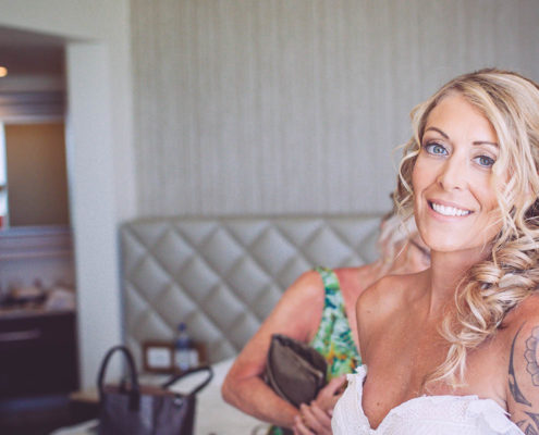 happy bride relaxed and excited for destinationw wedding to start