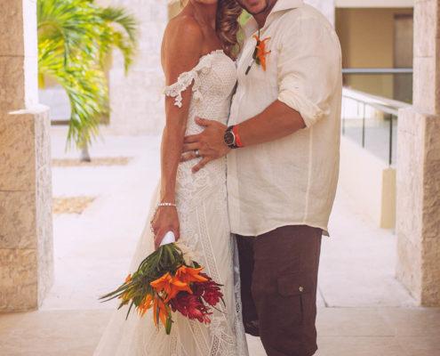bride and groom smile after wedding