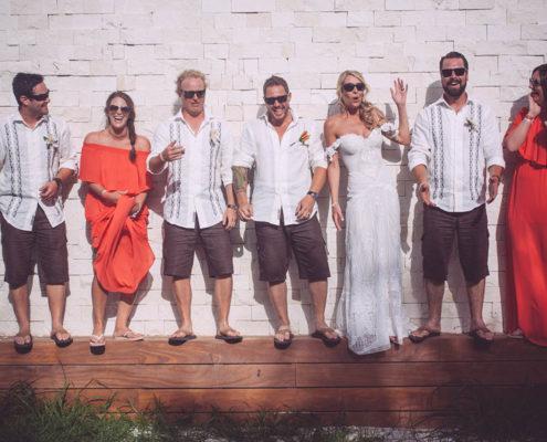 wedding party pose along wall