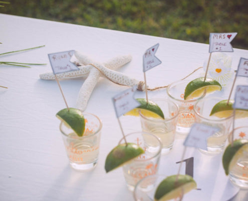 drinks with lime wedges on table